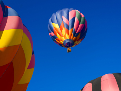 picture of a champagne balloon flight in a very blue sky