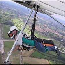 picture of two people in a dual hang glider